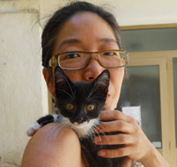 Kat and abandoned kitten, Olivo before adoption at the shelter. 2010